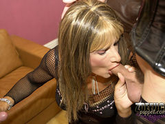Two cock sucking crossdressers take mouthfuls of cock in this group orgy
