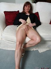 Horny Luci May rips open her nylon pantyhose and wanks her big erect cock into her high heel shoe