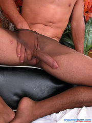 Kinky guy in tan pantyhose shooting a load after nasty games with his cock